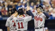Atlanta Braves' Freddie Freeman celebrates his three-run home run during the sixth inning of interleague baseball action against the Toronto Blue Jays, in Toronto, on May 15, 2017. (Mark Blinch/THE CANADIAN PRESS)