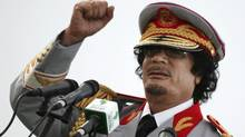 Former Libyan leader Moammar Gadhafi talks during a ceremony to mark the 40th anniversary of the evacuation of the American military bases in the country, in Tripoli, Libya. Libyan athletes can now look forward to the future with optimism after the ruthless dictator's death. (AP Photo/ Abdel Magid Al Fergany, File) (Abdel Magid Al Fergany/AP)