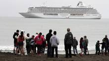 People preparing to take a polar plunge in the Bering Sea in front of the luxury cruise ship Crystal Serenity, which anchored just outside Nome, Alaska on Aug. 21, 2016. (Mark Thiessen/THE ASSOCIATED PRESS)