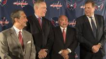 From left, Washington Capitals hockey team owner Ted Leonsis, new general manager Brian McLellan, new head coach Barry Trotz and team president Dick Patrick smile during a news conference Tuesday, May 27, 2014 in Washington. (AP Photo/The Washington Post)
