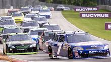 AER Chevrolet driver Ron Fellows (7) rounds turn five coming out of a caution in lap nine during the NASCAR Nationwide Series auto race at Road America in Elkhart Lake, Wis., Saturday, June 25, 2011. Reed Sorenson won the race. (John Ehlke/John Ehlke/AP Photo)