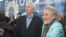 Bloc Quebecois Leader Gilles Duceppe, left, is joined by Parti Quebecois Leader Pauline Marois as they begin a long day of travelleing together as the campaign comes to an end Saturday, April 30, 2011 in Longueuil Que. Canadians are going to the polls on Monday May 2. (Jacques Boissinot/The Canadian Press)