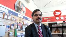 Canada Post CEO Deepak Chopra pose for a photograph Dec. 16, 2013 in Ottawa. (Dave Chan/The Globe and Mail)