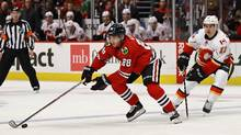 Kane Picks Up Three Points As Blackhawks Beat Flames