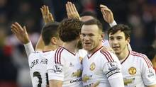 Manchester United's Wayne Rooney celebrates a 1-0 win over Liverpool with teammates on Jan. 17. (Carl Recine/REUTERS)