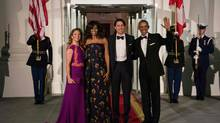 U.S. President Barack Obama (R), Canadian Prime Minister Justin Trudeau (2nd R) and their wives Michelle Obama (2nd L) and Sophie Grégoire-Trudeau (L) pose for a photo before the State Dinner. (Nicholas Kamm/AFP/Getty Images)