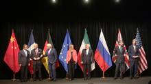 The Chinese Foreign Minister Wang Yi, French Foreign Minister Laurent Fabius, German Foreign Minister Frank-Walter Steinmeier, European Union High Representative Federica Mogherini, Iranian Foreign Minister Mohammad Javad Zarif, British Foreign Secretary Philip Hammond and U.S. Secretary of State John Kerry, from left, pose for a group photo following talks with Iran on their nuclear program in Vienna, Austria, Tuesday, July 14, 2015. (Ronald Zak/AP)