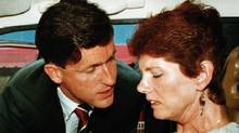 Sue Rodriguez is consoled by NDP MP Svend Robinson after leaving a press conference in Victoria in September, 1993, after The Supreme Court of Canada turned down Rodriguez's plea to a doctor assisted suicide. (Jeff Vinnick/ REUTERS)