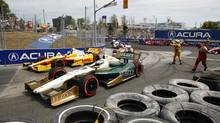 Andretti Autosport driver Ryan Hunter-Reay, rear, drives to first place during a yellow flag following a crash at Turn 3, as Ed Carpenter waits to be put back in the race at the Honda IndyCar race in Toronto on July 8, 2012. (MARK BLINCH/REUTERS)