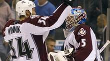 Colorado Avalanche goaltender Jean-Sebastien Giguere and left winger Daniel Winnik celebrate their overtime win against the Toronto Maple Leafs in NHL action in Toronto on Monday October 17, 2011. THE CANADIAN PRESS/Frank Gunn (Frank Gunn)