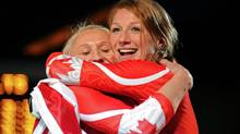 Kaillie Humphries and Heather Moyse, right, celebrate their gold medal win following the women's bobsleigh, Wednesday, Feb. 24, 2010, at the 2010 Vancouver Olympic Winter Games in Whistler, B.C. (Mathew McCarthy/THE CANADIAN PRESS)
