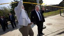 Mayor Rob Ford visits the scene on Tuesday where a shooting killed two and injured 23 others at a neighbourhood barbecue in Scarborough. (Moe Doiron/The Globe and Mail)