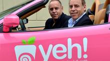 Jon Gurman, in the driver's seat of this pink Ferrari, and Marvin Gurman are the founders of Yeh Yogurt. (Bayan Alsheikh)