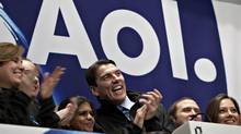 Tim Armstrong, chairman and chief executive officer of AOL Inc., center, laughs during the opening bell ceremony at the New York Stock Exchange in New York, U.S., on Thursday, Dec. 10, 2009. (Daniel Acker/Bloomberg)
