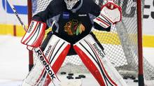 Blackhawks goalie Corey Crawford works on glove saves during a team practice in Chicago on Friday. Game 5 of the Stanley Cup final series against the Boston Bruins is Saturday. (JEFF HAYNES/REUTERS)