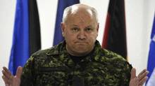 Canadian Lt. Gen. Charles Bouchard, NATO commander of the international military operation in Libya, gestures as he meets journalists at NATO headquarters, in Bagnoli, Naples, Italy, Tuesday, April 26, 2011. Bouchard has rejected a call for a ceasefire. (Salvatore Laporta/AP)