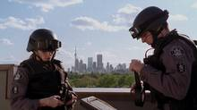 """Amy Jo Johnson as """"Jules"""" and Sergio Di Zio as """"Spike"""" in the CTV program Flashpoint, one of the first series set in Toronto to land a prime-time slot with a U.S. broadcaster."""