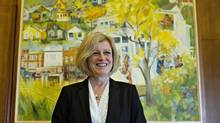 Alberta Premier Rachel Notley stands by a painting made for her office in Edmonton Alta, on Monday May 30, 2016. The premier is visiting Washington for the latest foray in a full-court press by Canadian politicians to preserve the country's lucrative relationship with its largest trading partner. (JASON FRANSON/THE CANADIAN PRESS)