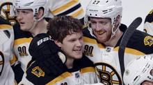 Boston Bruins' Matt Fraser, left, celebrates with teammate Dougie Hamilton after scoring the winning goal against the Montreal Canadiens during the first overtime period in playoff action Thursday, May 8, 2014 in Montreal. (Ryan Remiorz/THE CANADIAN PRESS)