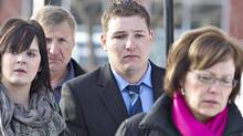 Brenden Holubowich walks with supporters as he makes his way to the courthouse for sentencing in the deaths of four high school football players, in Grande Prairie Alberta, on Tuesday February 26, 2013. (JASON FRANSON/THE CANADIAN PRESS)