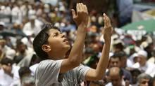 A Libyan boy attends Friday prayers in Benghazi on June 10, 2011. (MOHAMMED SALEM/MOHAMMED SALEM/REUTERS)