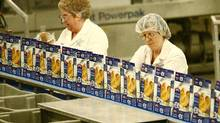 File photo of workers on the assembly line at a High Liner Foods plant in Lunenburg, N.S. (Paul Darrow for The Globe and Mail)
