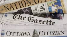Some of Postmedia's newspapers are displayed in Ottawa on January 8, 2010. (Adrian Wyld/THE CANADIAN PRESS)