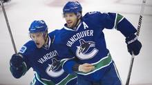 Vancouver Canucks' Mason Raymond and Ryan Kesler celebrate their team's goal during the first period of game seven of NHL hockey playoff action in Vancouver April 26, 2011 agaist the Chicago Blackhawks. (JOHN LEHMANN/JOHN LEHMANN/THE GLOBE AND MAIL)