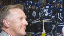 In this file photo, Toronto Maple Leafs new head coach Ron Wilson listens to questions from the media in Toronto on Tuesday June 10, 2008. THE CANADIAN PRESS/Frank Gunn (Frank Gunn)