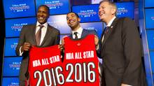 Toronto Raptors general manager Masai Ujiri (L), rapper Drake, and President and CEO of Maple Leaf Sports and Entertainment Tim Leiwekea (R) pose after an announcement that the Toronto Raptors will host the NBA All-Star game in Toronto, September 30, 2013. (Peter Power/The Globe and Mail)