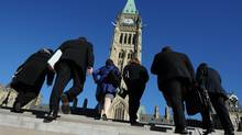 Parliament Hill in Ottawa. If the Conservatives want to demonstrate that they have a small-government agenda, cutting spending is not a particularly informative signal: (Sean Kilpatrick/Sean Kilpatrick/The Canadian Press)