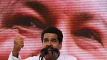 Venezuela's Vice President Nicolas Maduro speaks in front of a screen with an image of President Hugo Chavez during a rally in Caracas, Jan. 23, 2013. Mr. Maduro has blamed food shortages on the private sector, alleging it is trying to force an increase in prices and a devaluation of the official exchange rate. (JORGE SILVA/REUTERS)