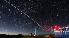 "A time lapse photo taken on Dec. 9, 2016 shows a laser guided satellite-to-earth link between the Chinese quantum satellite ""Micius"" and a ground observatory in Ali, in southwest China's Tibet Autonomous Region. (Xinhua/Jin Liwang)"