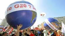 Anti-G8 activits hold globes reading 'Hello G20? This is the rest of the world' as they take part in a demonstration on May 21 in Le Havre in northwestern France. (DAMIEN MEYER/AFP/Getty Images)