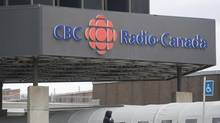 A man stands outside the CBC/Radio-Canada building in Montreal, Wednesday, April 4, 2012. (Graham Hughes/THE CANADIAN PRESS)
