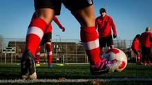 Canadian national women's soccer team captain Christine Sinclair, centre, and her teammates practice in Burnaby, B.C., in this Nov. 20, 2013 file photo. Sinclair was part of Canada's best finish in the U-20 Women's World Cup in 2002, when the team lost 1-0 to the U.S. in the final. (DARRYL DYCK For The Globe and Mail)