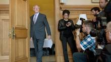 Mayor Gerald Tremblay arrives to speak to reporters in Montreal on Monday. His mayoral position is being called into question as a result of a construction finance scandal. (Graham Hughes/THE CANADIAN PRESS)