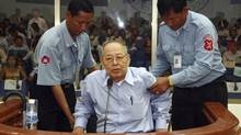 A June 2008 file photo shows former Khmer Rouge foreign minister Ieng Sary being assisted during his pre-trial hearing at the Extraordinary Chambers in the Courts of Cambodia on the outskirts of Phnom Penh. (Print Samrang/Pool/REUTERS)