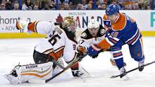 Anaheim Ducks goalie John Gibson (36) makes the save on Edmonton Oilers' Nail Yakupov (10) as Hampus Lindholm (47) defends during first period NHL action in Edmonton, Alta., on Monday March 28, 2016. (JASON FRANSON/THE CANADIAN PRESS)