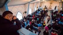 Sunday worshippers pray for the victims of Friday's mass shooting in La Loche, Saskatchewan. (John Lehmann/The Globe and Mail)