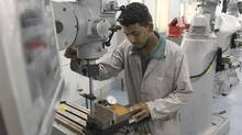 A mechanical technician industrial millwright student works at Algonquin College Jazan Saudi Arabia campus. (Algonquin College photo)