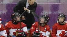 Canadian head coach Kevin Dineen talks to the players on the bench during a break in the action against the United States in the third period of the women's gold medal ice hockey game at the 2014 Winter Olympics, Thursday, Feb. 20, 2014, in Sochi, Russia. (Petr David Josek/AP)