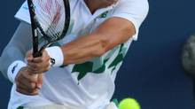 Milos Raonic, of Canada, returns a volley to Robby Gineprir at the Western & Southern Open tennis tournament, Wednesday Aug. 13, 2014, in Mason, Ohio. (TOM UHLMAN/AP)