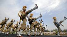 Security officers march in a parade on the outskirts of Hyderabad on Tuesday to recognize their completion of basic training. In india, criticism of security forces is sometimes viewed as unpatriotic, muting criticism of the torture of suspects by police. (Krishnendu Halder/Reuters)
