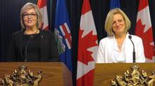 Sandra Jansen, left, and Premier Rachel Notley, speak at the legislature in Edmonton on Nov. 17, 2016. (Dean Bennett/THE CANADIAN PRESS)