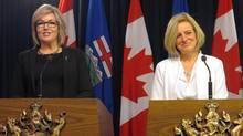 Sandra Jansen, left, and Premier Rachel Notley, speak at the legislature in Edmonton on Nov. 17, 2016. (Dean Bennett/THE CANADIAN PRESS)