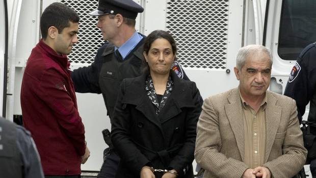 Mohammad Shafia, Tooba Yahya and their son Hamed Shafia are escorted into the Frontenac County courthouse in Kingston, Ont. Jan. 26, 2012. (Frank Gunn/THE CANADIAN PRESS)