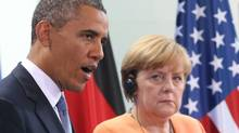 In this June 19, 2013 file picture US President Barack Obama speaks during a press conference with German Chancellor Angela Merkel, right, at the Chancellery in Berlin (Michael Kappeler/AP)
