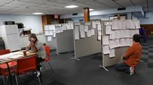 A job seeker checks a job board at the Canadian Auto Workers Union building in London, Ont. As of August, average Canadian wage growth had risen at a monthly average of 2.8 per cent, compared to 2.1 per cent for the same period in 2011. (Deborah Baic/The Globe and Mail)