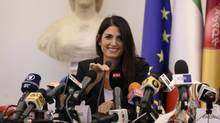 Rome Mayor Virginia Raggi smiles during a press conference after she did not show up at a scheduled meeting with a delegation of the Italian Olympic Committee, in Rome, Wednesday, Sept. 21, 2016. (Alessandra Tarantino/AP)